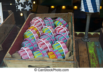 the Woven multicolored boxes in a shop window of a Mexican store