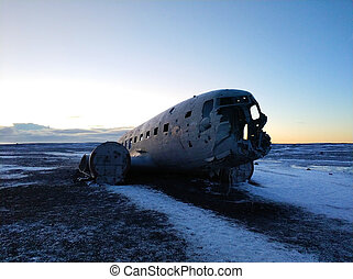 The wreckage of an abandoned DC 3 plane on a black ocean ...