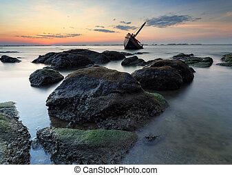 The wrecked ship on stone beach, Thailand