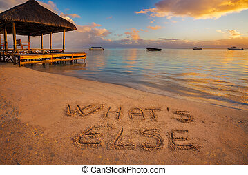 "The written ""What's else"" - Forground written in the sand..."