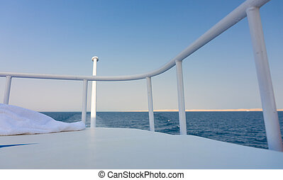 The yacht deck during sailing on a beautiful blue sea