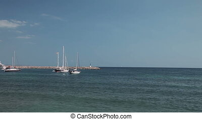 The yacht is anchored next to the beach area. Spanish beaches in Costa d'en Blanes. Mallorca