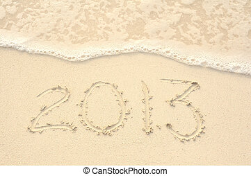 The Year 2013 Written in Sand on Beach