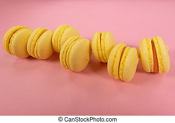 yellow cookies on a pink background