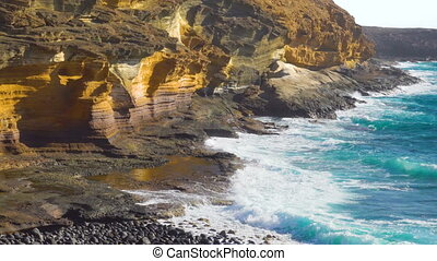 The Yellow Mountain on the ocean shore in Costa del...
