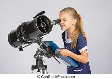 The young astronomer happy to look through the telescope...