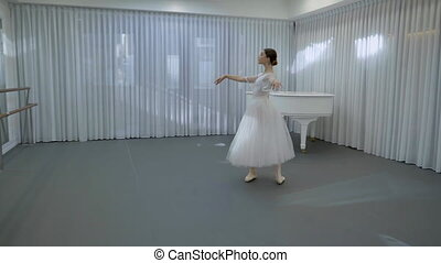 The young ballerina trains to do fouette on her left leg in...