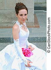 bride against brick wall