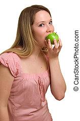 young beautiful girl eats a green apple