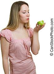 girl eats a green apple