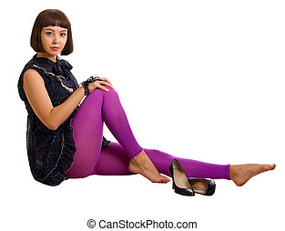 young beautiful girl in a dark dress and lilac stockings
