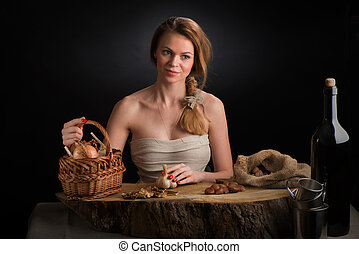 The young beautiful girl in a sundress from canvas sits at...