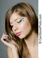 The young beautiful girl with a creative make-up