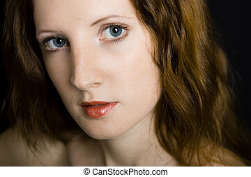 The young beautiful girl with freckles