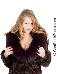 The young beautiful woman in a fur coat over white