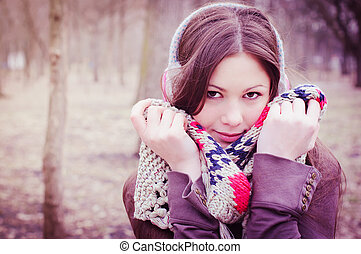 The young beautiful woman in park