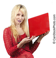 The young beautiful woman in  red blouse  with the red laptop