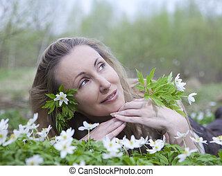 beautiful woman on a glade of bloss