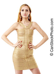The young beautiful women in a golden dress. Isolation on a whit