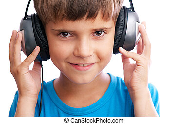 The young boy is holding the headphones