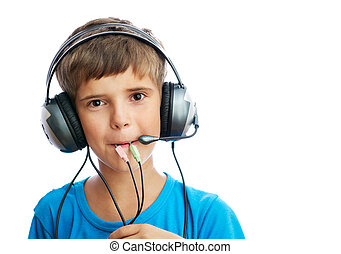 The young boy is listening to music