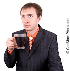The young businessman drinks coffee