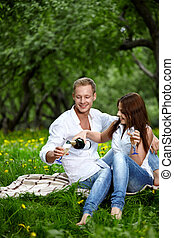 The young enamored - The attractive enamored couple drinks ...