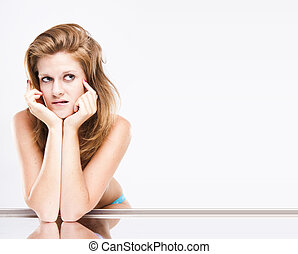 The young funny girl isolated on a white background