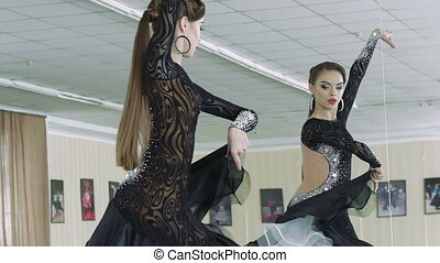 The young girl engaged in ballroom dancing. Slow motion