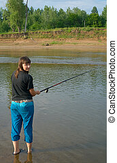 girl fishes a fishing
