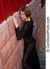 girl in black dress at ladder