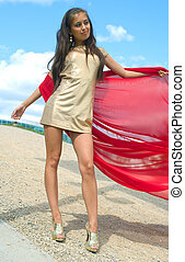 girl in golden dress with red scarf