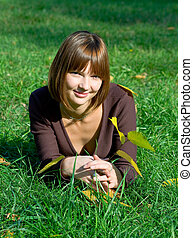 young girl on a green grass