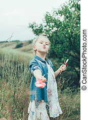 The young girl on green grass background