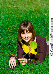 young girl on green grass