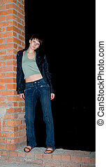 girl on red brick wall