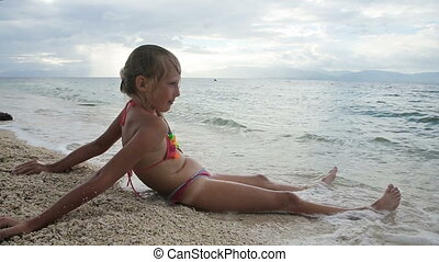 The young girl on the beach