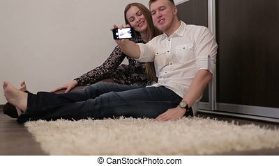 The young happy couple doing selfie, smiling.