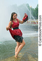 laughing girl in wet clothes