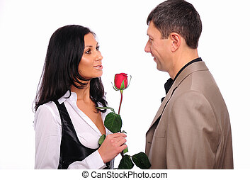 young man gives his girlfriend a rose