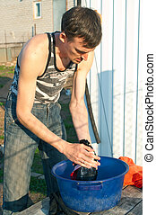 man hands washes clothes