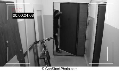 the young man in mask breaks the door and steals a bike -...