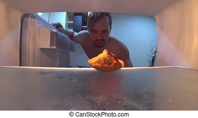 The young man opens the refrigerator. He's upset that the...