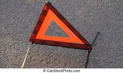 the young man removes emergency sign from the road