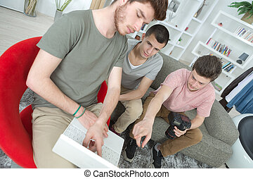the young men using laptop
