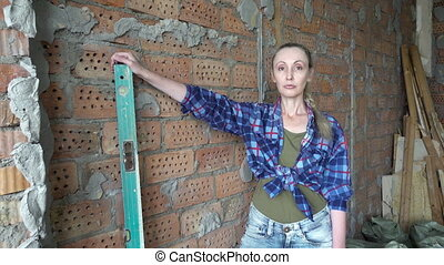 The young slender woman in plaid shirt and blue jeans...
