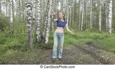 The young slender woman with long svetly hair in a t-shirt...