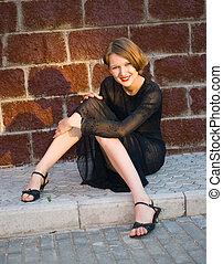 smiling girl in black dress