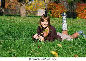 smiling girl on a green grass