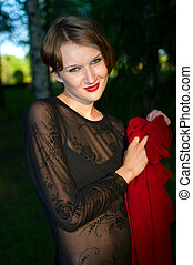 women in black dress with red scarf